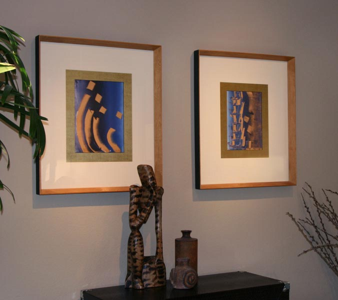 Modern art in interior with african sculpture and framed mono prints by Mark G. Picascio