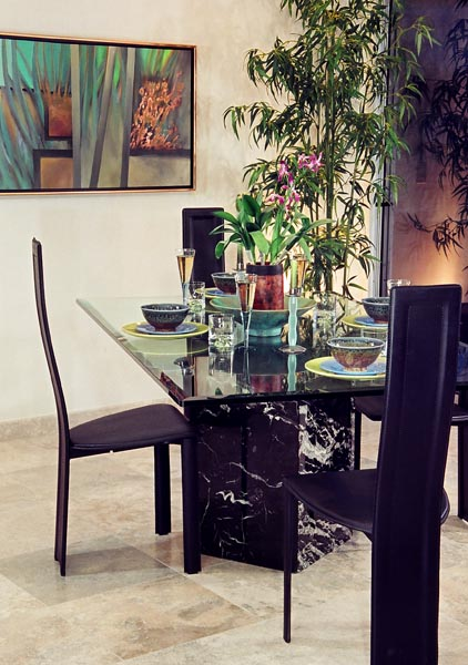 "Modern dining room setting with abstract painting ""Distant Lines"""