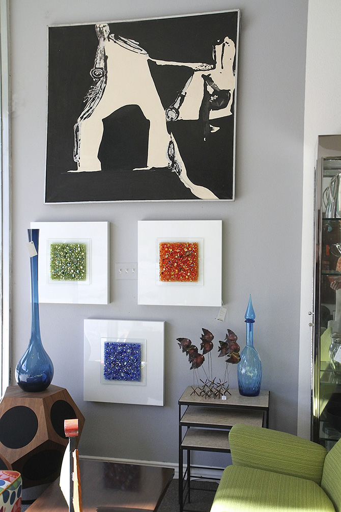 Painting by Roma Bogard and abstract glass art by Sean Kenny