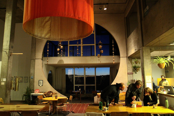 Students in the dining hall at sunset, Arcosanti