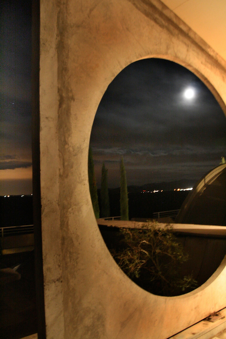 Circular openings at Arcosanti under moonlite night