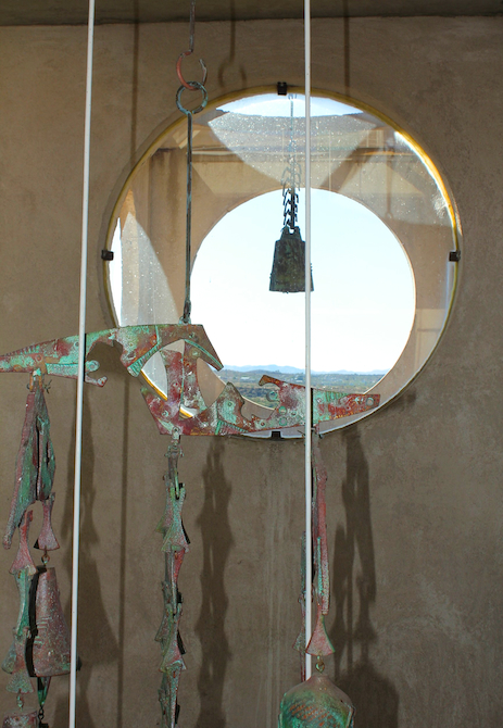 Patina Bronze colored sculpture with round porthole windows at Arcosanti