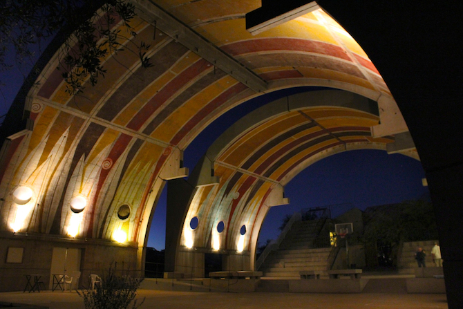 Glimpse of the vaults at night with lights at Arcosanti