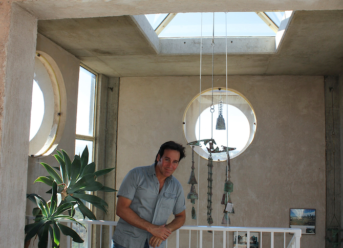 Mark G. Picascio at the top of the stairway in the Visitor Center at Arcosanti