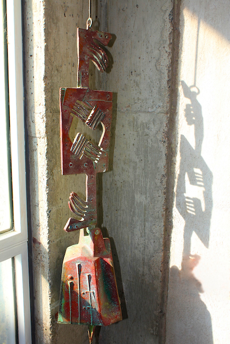 Hand made bronze colored wind bell at Arcosanti