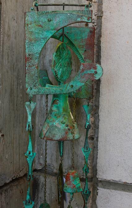 Patina green bronze bell at Arcosanti