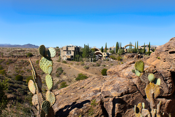 View of Arcosanti through cactus and rocks
