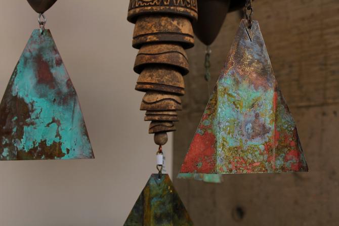 Close-up of patina copper and ceramic wind bells at Arcosanti