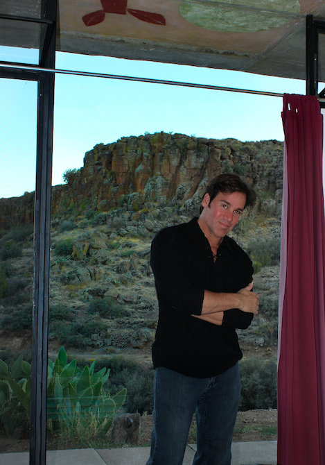 Mark G. Picascio in guest room with canyon views at Arcosanti, AZ